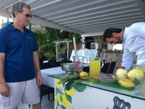 Chef Fiore on the Amalfi Coast teaches the group how to make Limoncello
